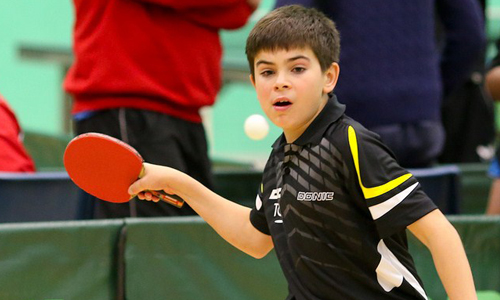 Photo of child playing table tennis